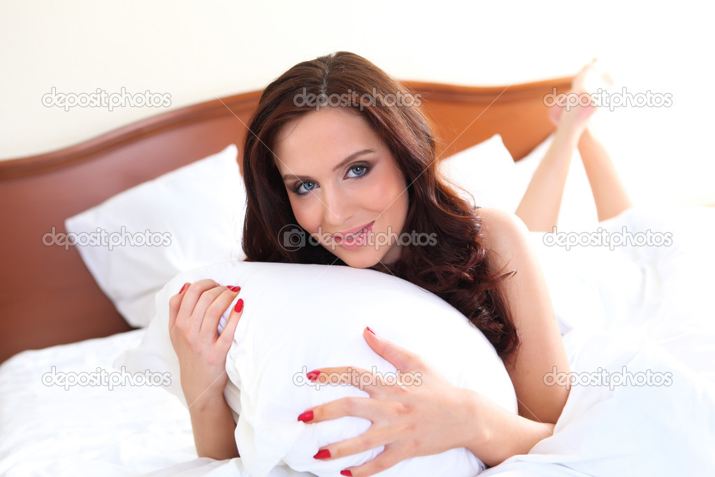 Portrait of a young pretty woman in bed in underwear  Stock Photo #5551748