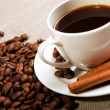 Cup of coffee with tubes of cinnamon — Stock Photo #5634666