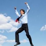 joven empresario en una camisa azul de salto — Foto de Stock