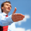 Young businessman in a blue shirt and red tie — Stock Photo