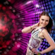 Young woman dancing at disco - Stock Photo