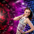 Stock Photo: Young woman dancing at disco