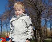 Young boy walks in the park — Stock Photo