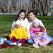 Stock Photo: Little girls with parents in spring park
