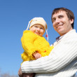 Little girl with father in spring park - Stock Photo