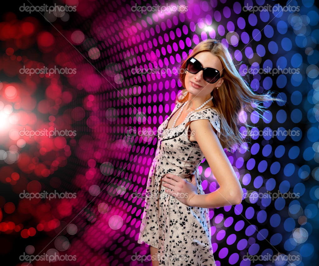 Young woman dancing at disco or a night club — Stock Photo #5693325