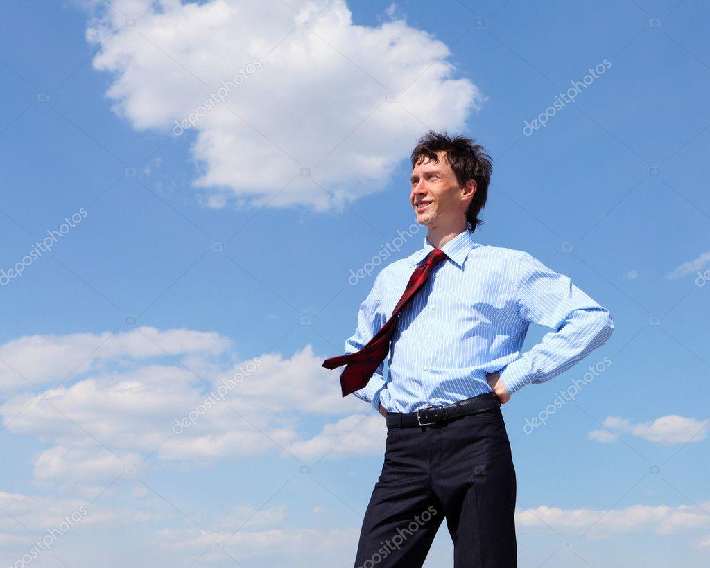 junger gesch ftsmann in ein blaues hemd und eine rote krawatte stockfoto sergeynivens 5703890. Black Bedroom Furniture Sets. Home Design Ideas