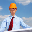 Young engineer in a blue shirt and yellow helmet — Stock Photo #5716021