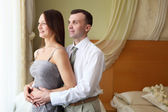 Young couple near the window — Stock Photo