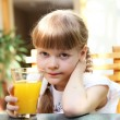 Stock Photo: Portrait of little girl with orange juice