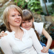 Stock Photo: Young mother with her little daughter