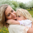 Girl with mother in the park — Stock Photo #5744614