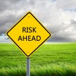 Road sign of risk ahead — Stock Photo #5746075