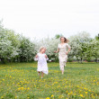 Girl with mother in the park — Stock Photo #5772937