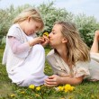 Girl with mother in the park — Stock Photo #5777419