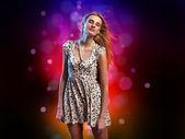 Young woman dancing at disco — Stock Photo