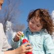 Little girl with mother in park - Stock Photo