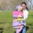 Little girl with mother in spring park - Stock Photo