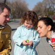 Litlle girl with parents in the park — Stock Photo #5782745