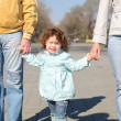 Litlle girl with parents in the park — Stock Photo #5782754