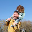 Litlle girl with father in the park - Stock Photo