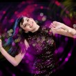 Young woman dancing at disco — Stock Photo