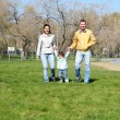 Litlle girl with parents in the park — Stock Photo