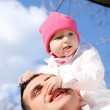 Litlle girl with father outdoors — Stock Photo