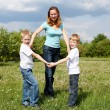 Mother with her two sons outdoors - Foto de Stock