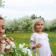 Girl with mother in the park — Stock Photo #5808914