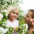 Girl with mother in the park — Stock Photo #5808964