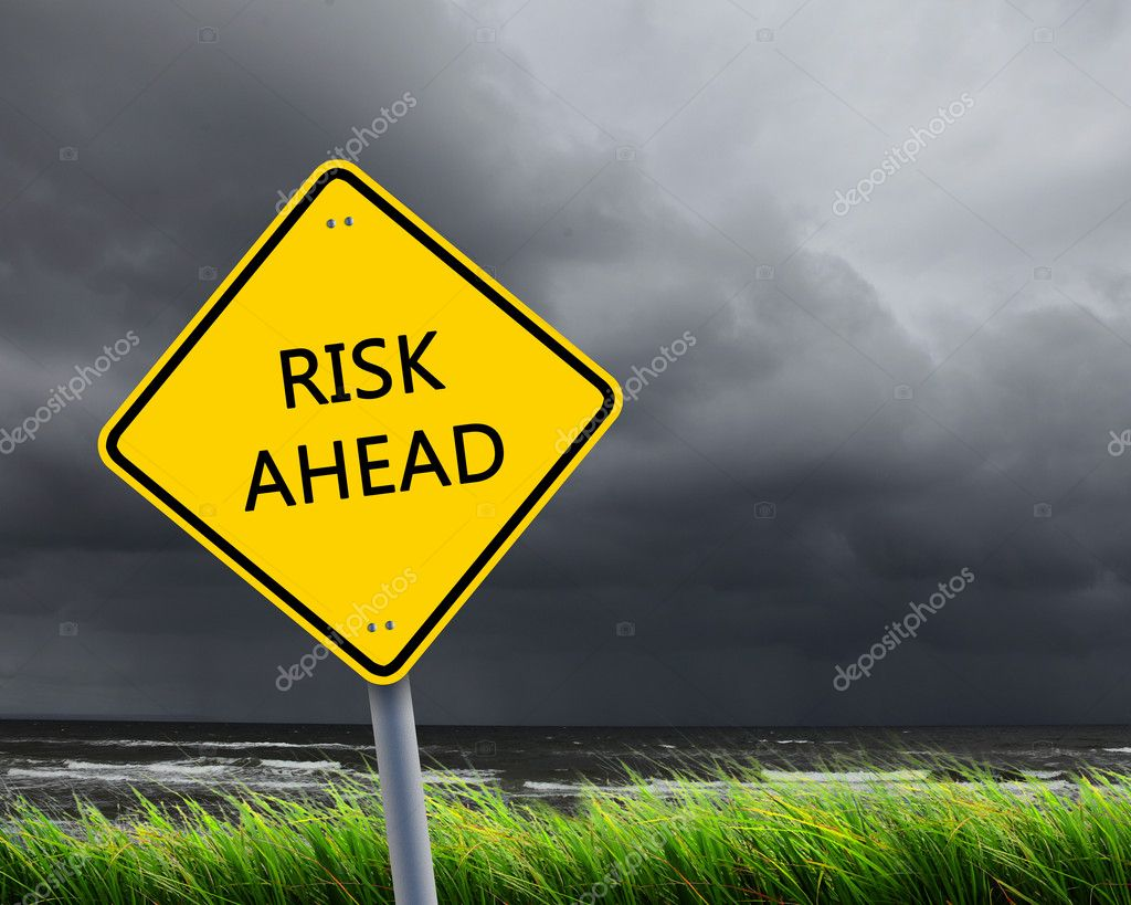 Yellow road sign as a warning of risk ahead — Stock Photo #5808940