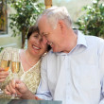 Senior couple drinking champagne — Stock Photo