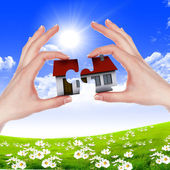 Hands holding house — Stock Photo