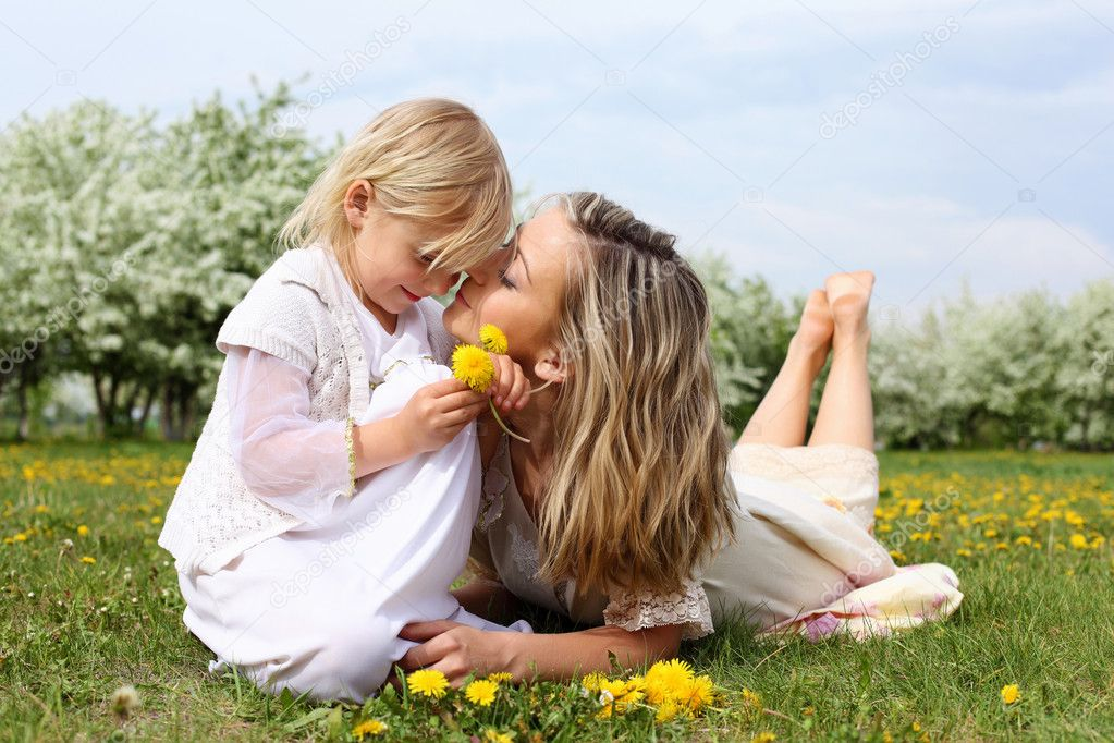 Happy girl and her mother in the spring park  Stock Photo #5831466