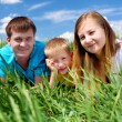Family with son on the meadow — Stock Photo