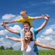 Family with children in summer day outdoors — Stock Photo #5848918
