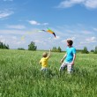 Royalty-Free Stock Photo: Father with son in summer with kite