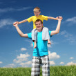 Father with son in summer day outdoors — Stock Photo #5849031