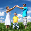 Family with children in summer day outdoors — Stock Photo #5849035