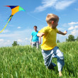 Father with son in summer with kite — Stockfoto #5849037