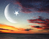 Muslim star and moon on blue sky — Stock Photo