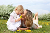 Girl with mother in the park — Photo