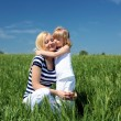 Mother with her daughter outdoors — Stock Photo #5856816