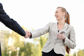 Shaking hands on a light background — Stock Photo