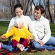 Little girls with parents in spring park — Stock Photo