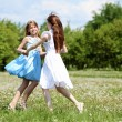 Two girls playing in the park — Stock Photo