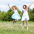 Two girls playing in the park - Foto Stock