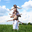 Family with children in summer day outdoors — Stock Photo #5878838