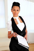 Young business woman with papers — Stock Photo